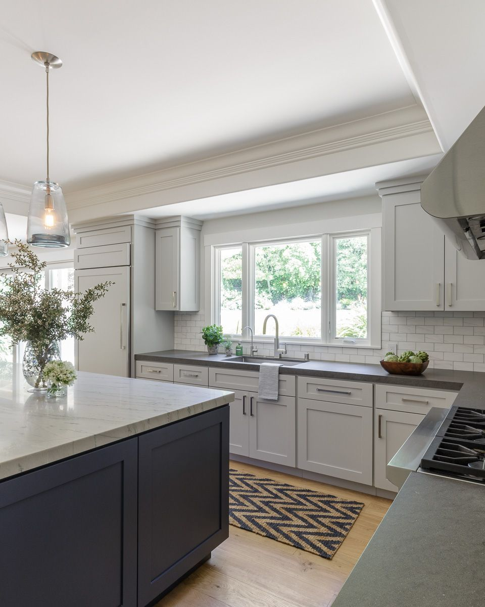 Kitchen; light gray cabinets, navy island and subway tile #graycabinets Kitchen; light gray cabinets, navy island and subway tile #graycabinets
