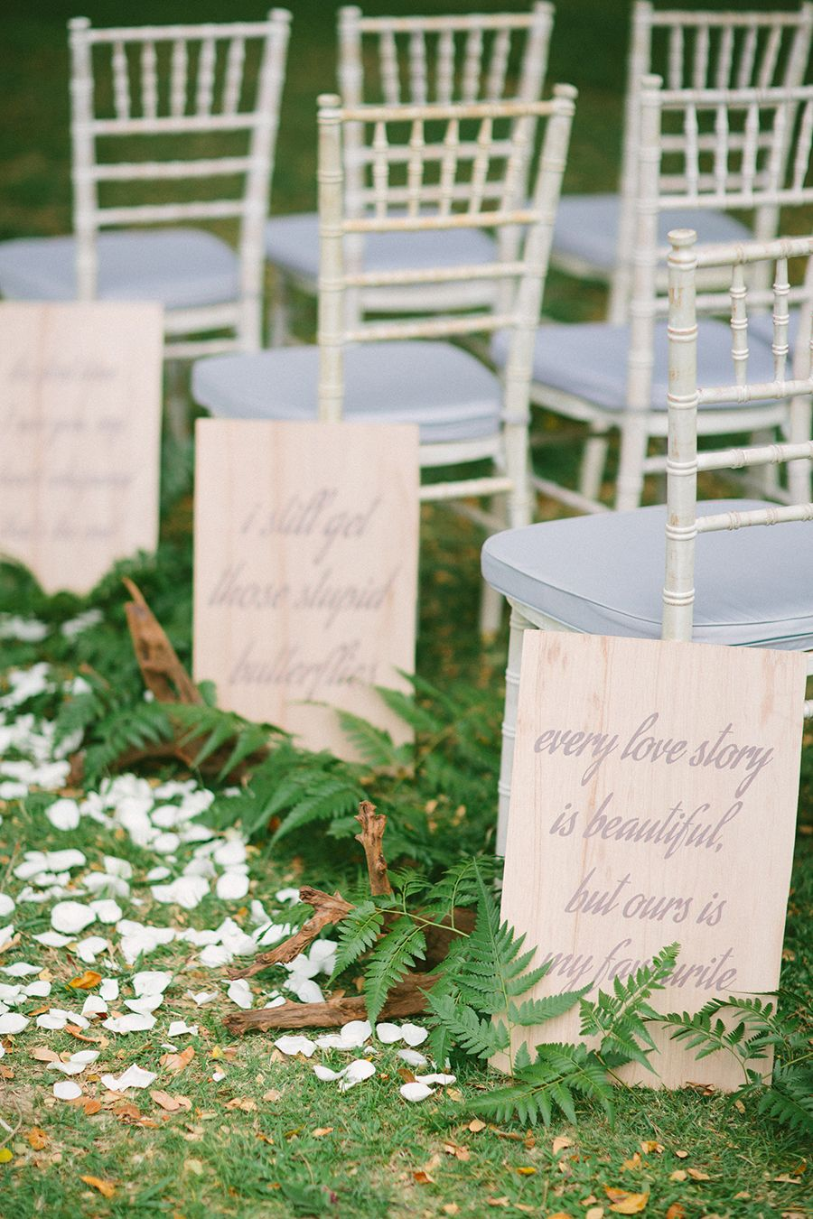Creative wedding backdrops a styled shoot anne et mathieu by hc along the aisle short love quotes are calligraphed onto plywood and decorated with driftwood and ferns creative wedding backdrops a styled shoot junglespirit Gallery