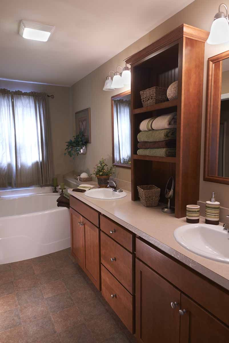 Add a cabinet tower between two sinks for added bathroom storage #design  Prefab Homes,