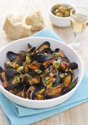 Mussels cooked in a green olive, Serrano ham and white wine sauce