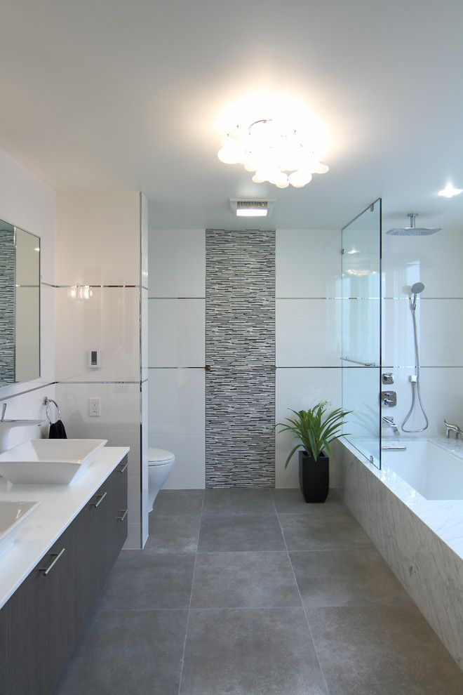 Contemporary Luxury Bathrooms bathroom with grey floor, carrara and feature tile inset. | house