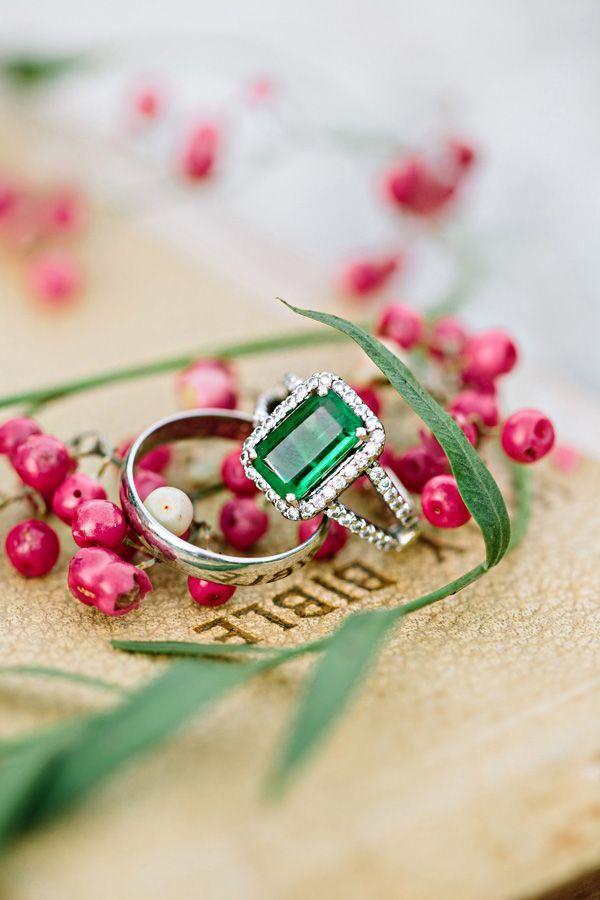 large emerald engagement ring resting on Bible @myweddingdotcom