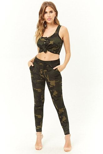 36876f8836ad1 DetailsA knit set in an allover camo print featuring a crop top with an  elongated front hem to tie a knot, a scoop neckline, sleeveless cut, ...