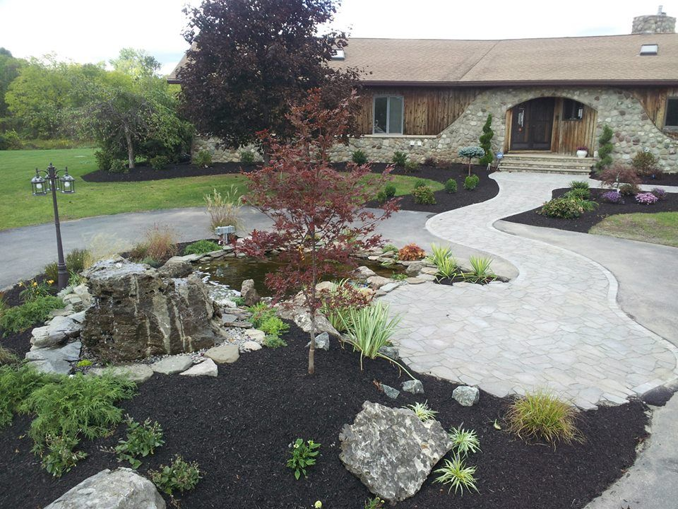A paver path across a concrete drive connects the inside for Circular driveway layout