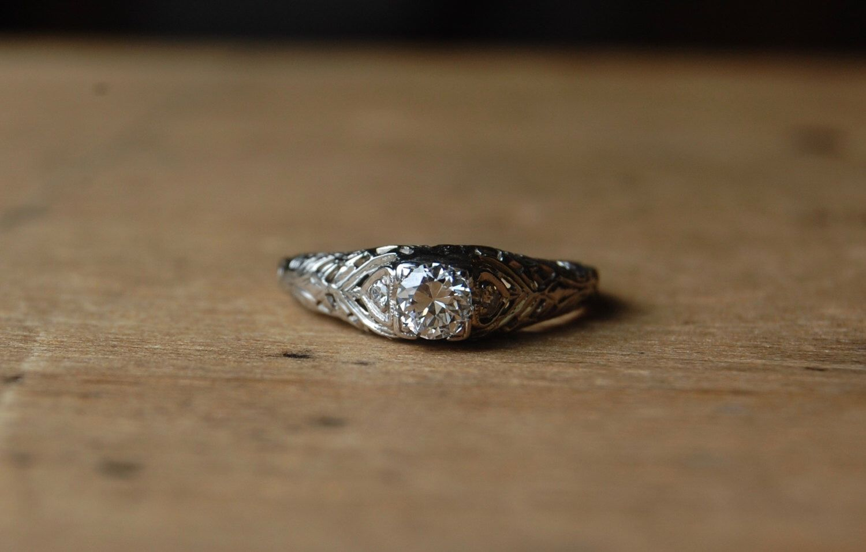 Art Deco 18K diamond filigree engagement ring by jeanjeanvintage on Etsy https://www.etsy.com/listing/254869273/art-deco-18k-diamond-filigree-engagement