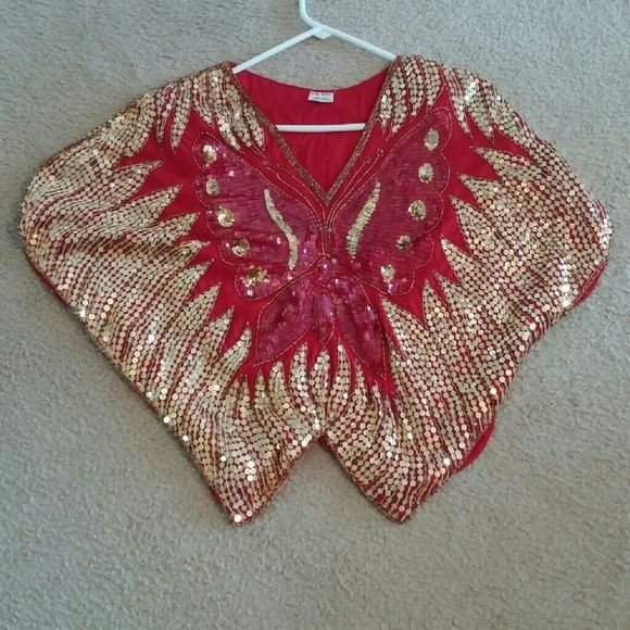 Sequined Butterfly top Wow..Nice top are the compliments you'll hear when you wear this beautiful top! Red and gold sequined with matching pattern on the back as well. Tops Crop Tops