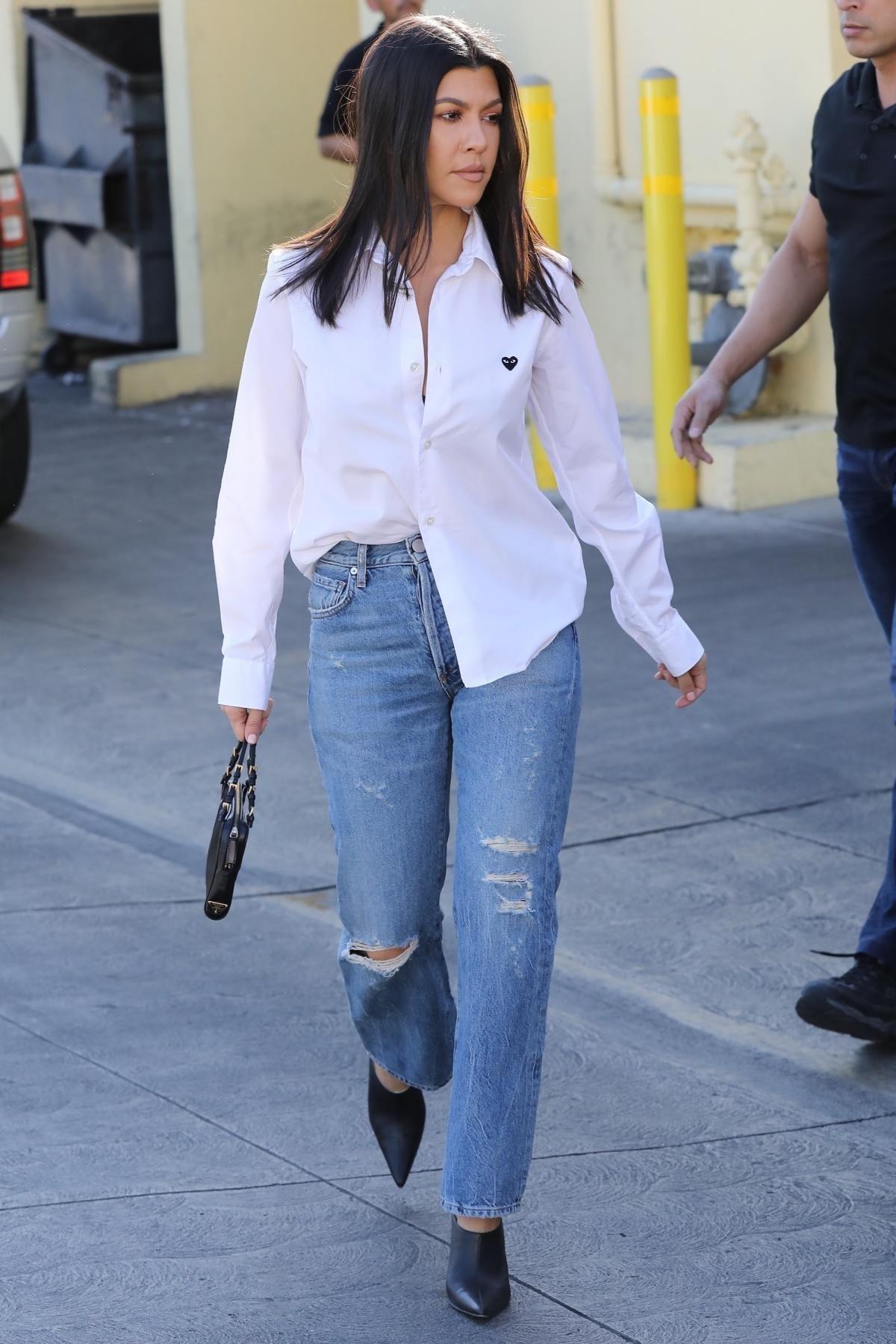 92c5e21b8eeea Kourtney Kardashian leaves Carousel Restaurant dressed in a white Commes  Des Garcons shirt and blue Jean Atelier jeans