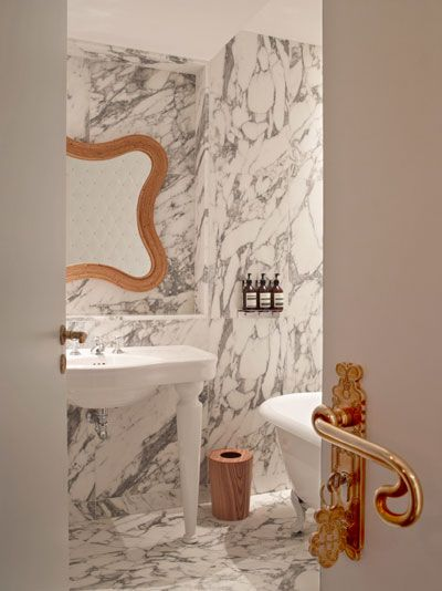 Hotel Thoumieux, Paris. LOVE that sexy handle (and marble-clad bathroom)!