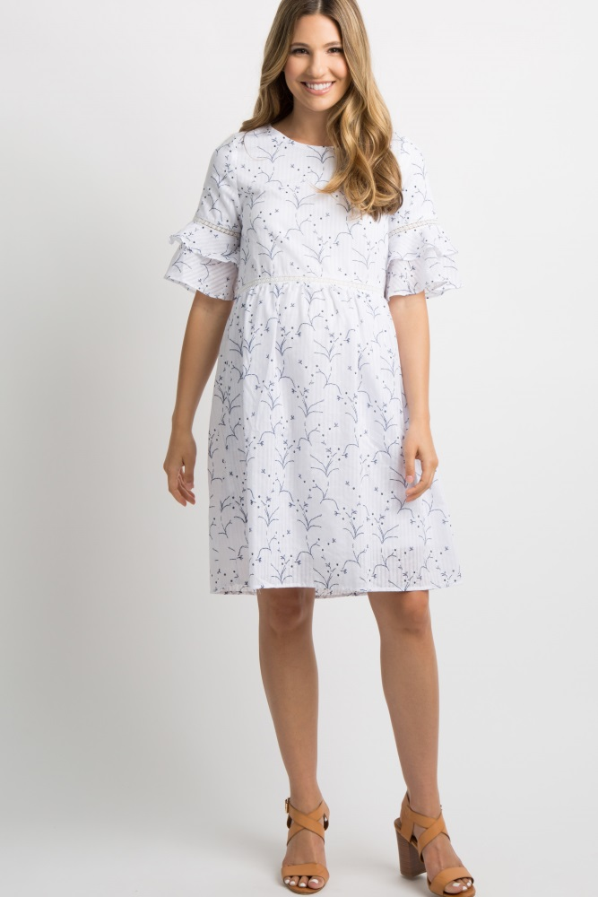 376c70cb20005 Ivory Floral Print Ruffle Midi Dress A floral print maternity dress  featuring a ruffle sleeve with crochet trim. Additional details include a  keyhole back ...