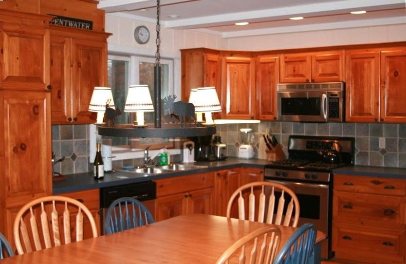 Kitchen - Knotty pine cabinets and newer stainless applicances
