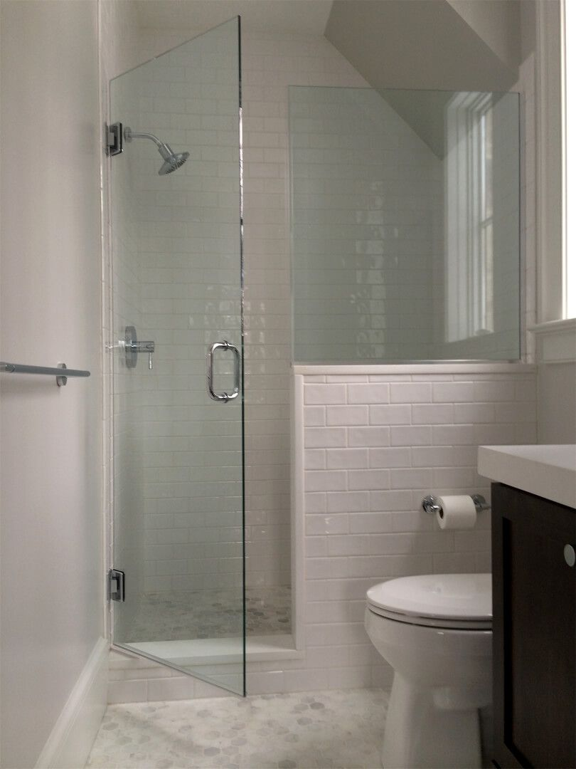 Frameless Shower Glass With Half Wall Panel Installed With Channels Bathroom Shower Doors Small Shower Remodel Shower Remodel