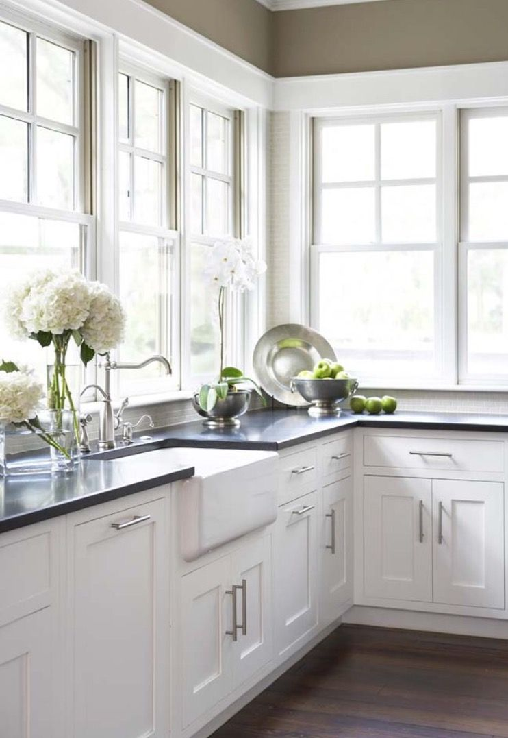 Sweet Kitchen Design With Khaki Walls Paint Color Farmhouse Sink And White Shaker Cabinets Honed Black Granite Counter Top
