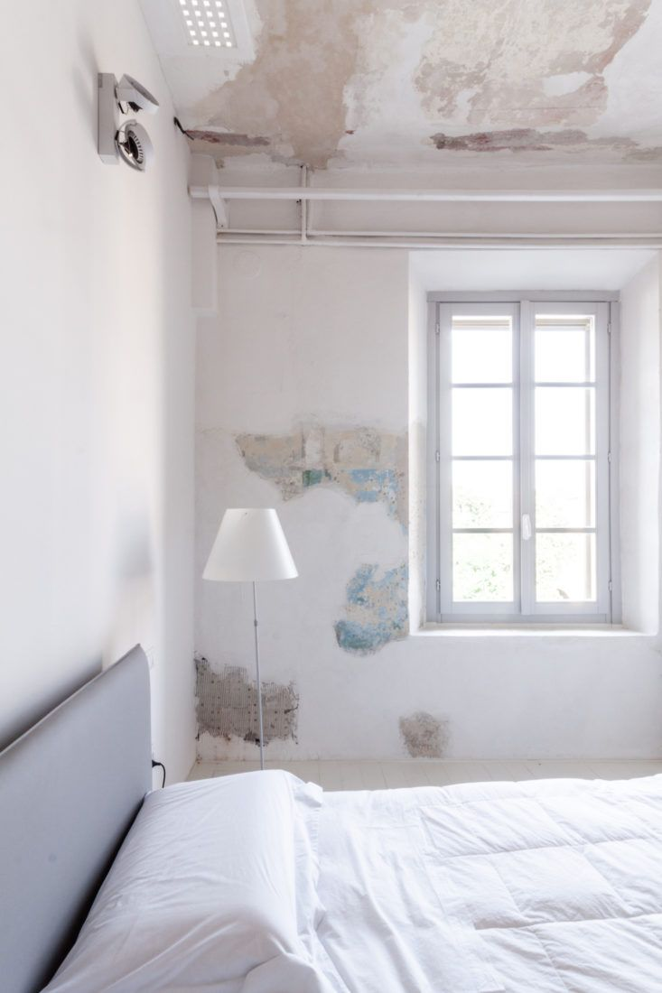 Hide water damage with distressed ceilings and walls
