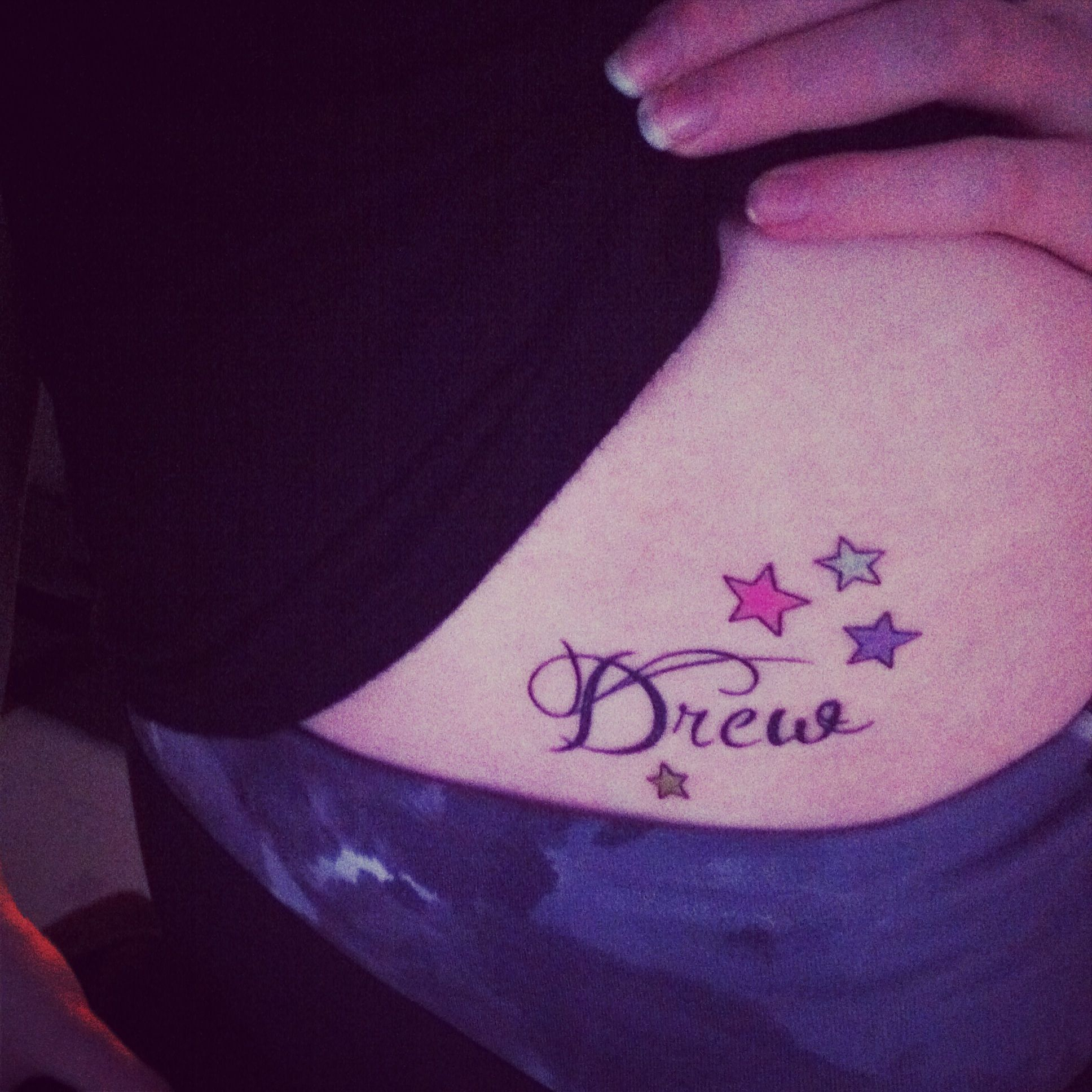 Hip tattoo of my last name. The Stars represent my family