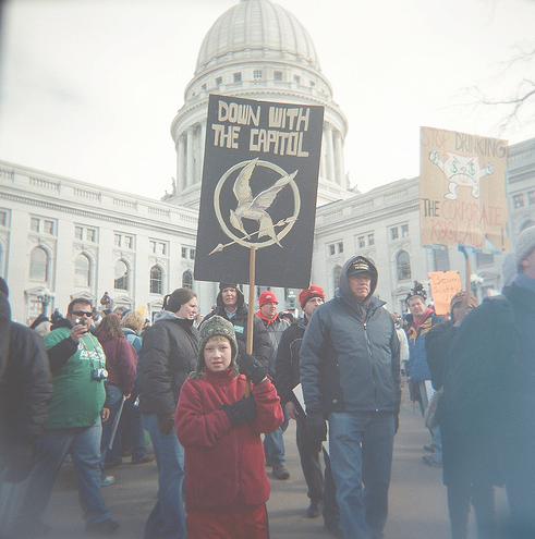 Hunger Games This Is One Of The Most Brilliant Protest Signs I Have Ever Seen Hunger Games Hunger Games Fandom Hunger