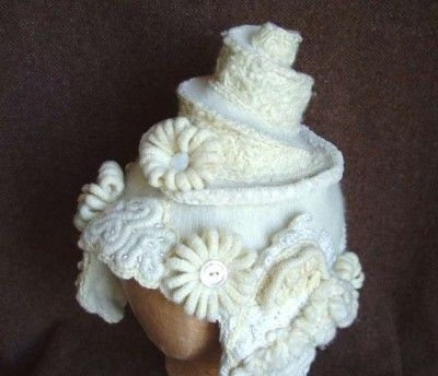 Wedding Cake Bridal Hat made from upcycled sweater and enhanced with freeform crochet.  Just something funny to pin. From WanderingLydia.