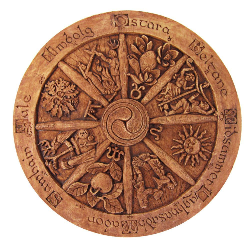 This stunning large Wheel of the Year Plaque in wood finish depicts the eight Pagan holidays or Sabbats. The Wheel of the Year is laid out as a traditional wooden wheel. Each pie-shaped section is a c