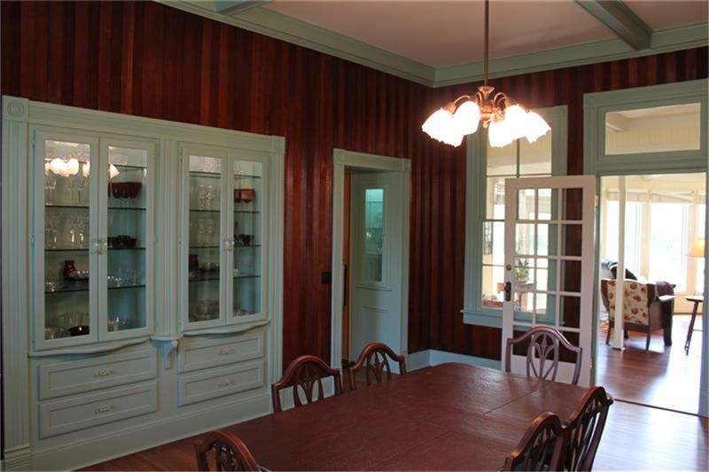 Lighted built in china cabinet with views of the informal den