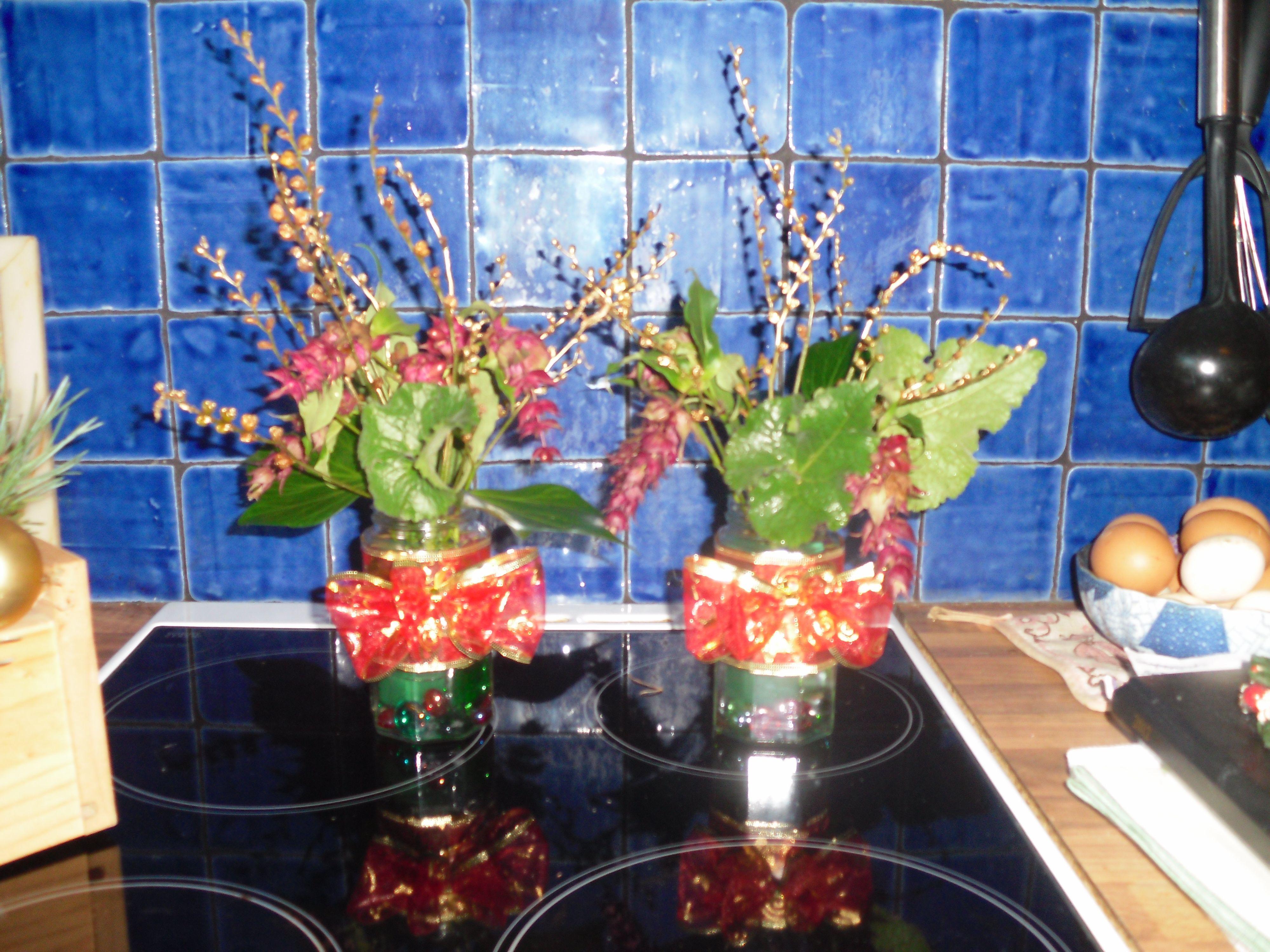 DIY Xmas Display. Fancy jars/bows/winter garden flowers and foliage
