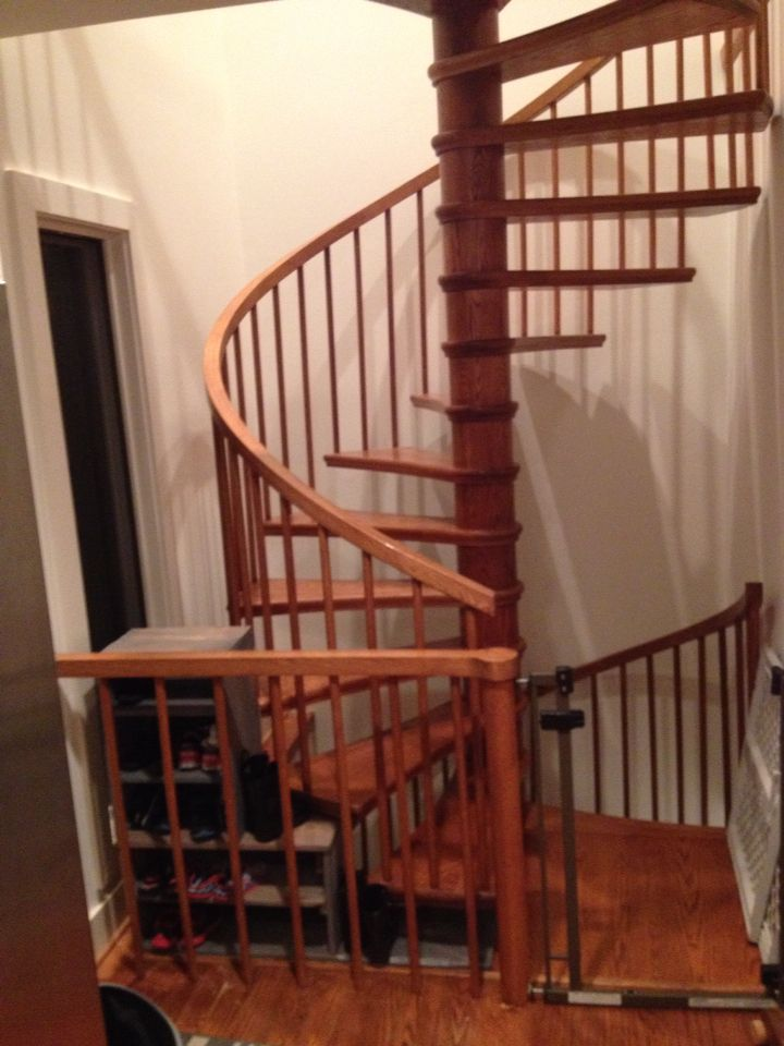 Floating shoe rack for spiral stairs. Made from pallet wood.