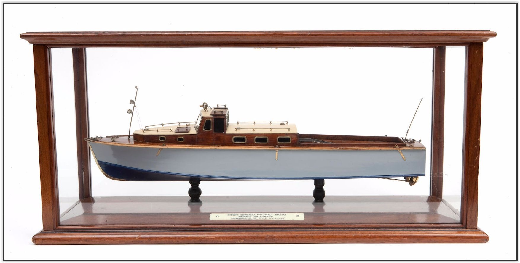 A shipbuilders' presentation model of a 45-foot naval picketboat, J. Samuel White of Cowes (British, circa 1934) The hull built up from the solid in 1:24 scale, painted and varnished mahogany detailed with brass fittings, supported by two turned pedestals in glazed mahogany case