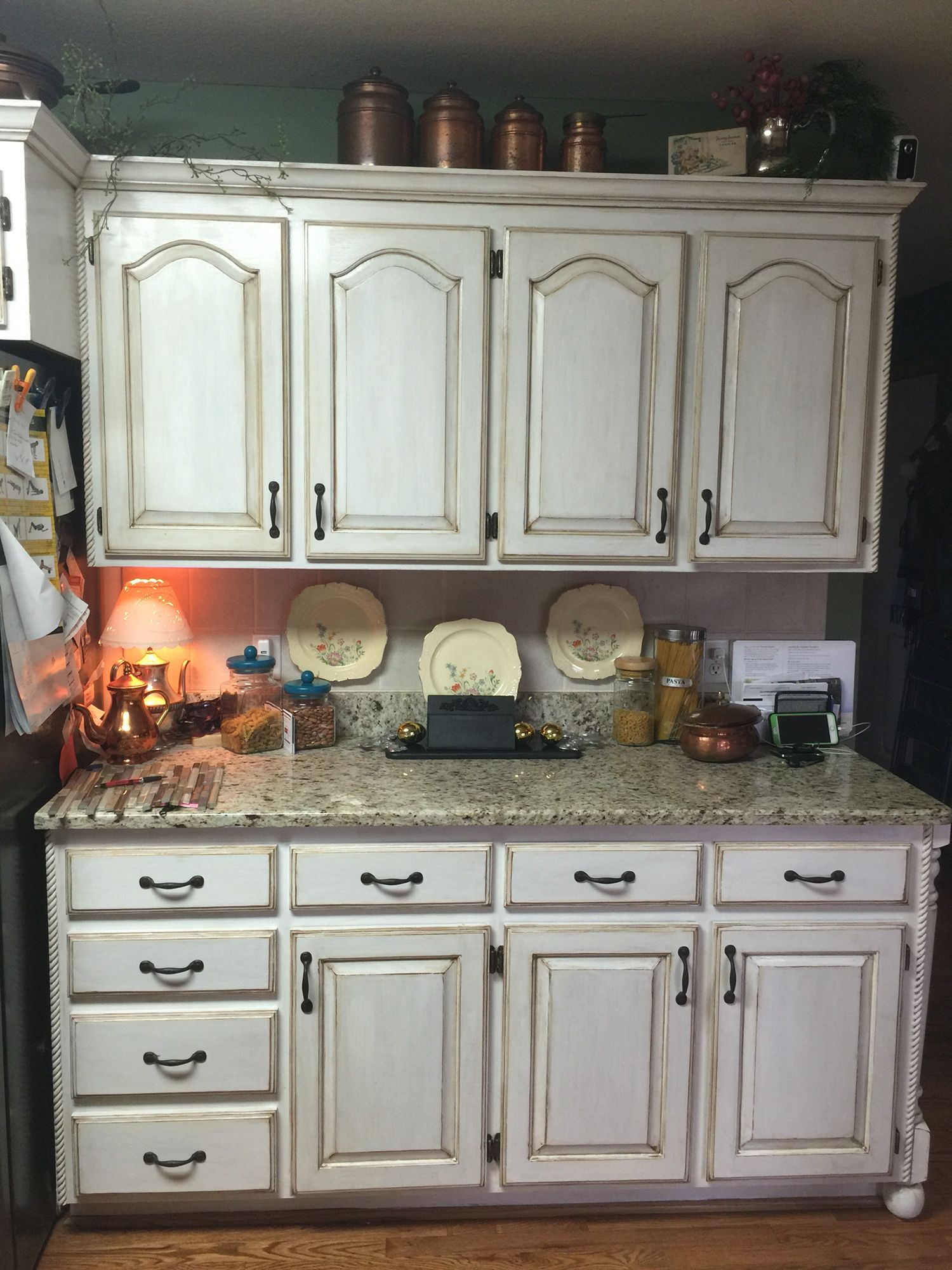 In Expensive Kitchen Cabinet Remodel In Progress White Chalk Paint Brown Antiquing Stain A Kitchen Cabinet Remodel Cabinet Remodel Painting Kitchen Cabinets