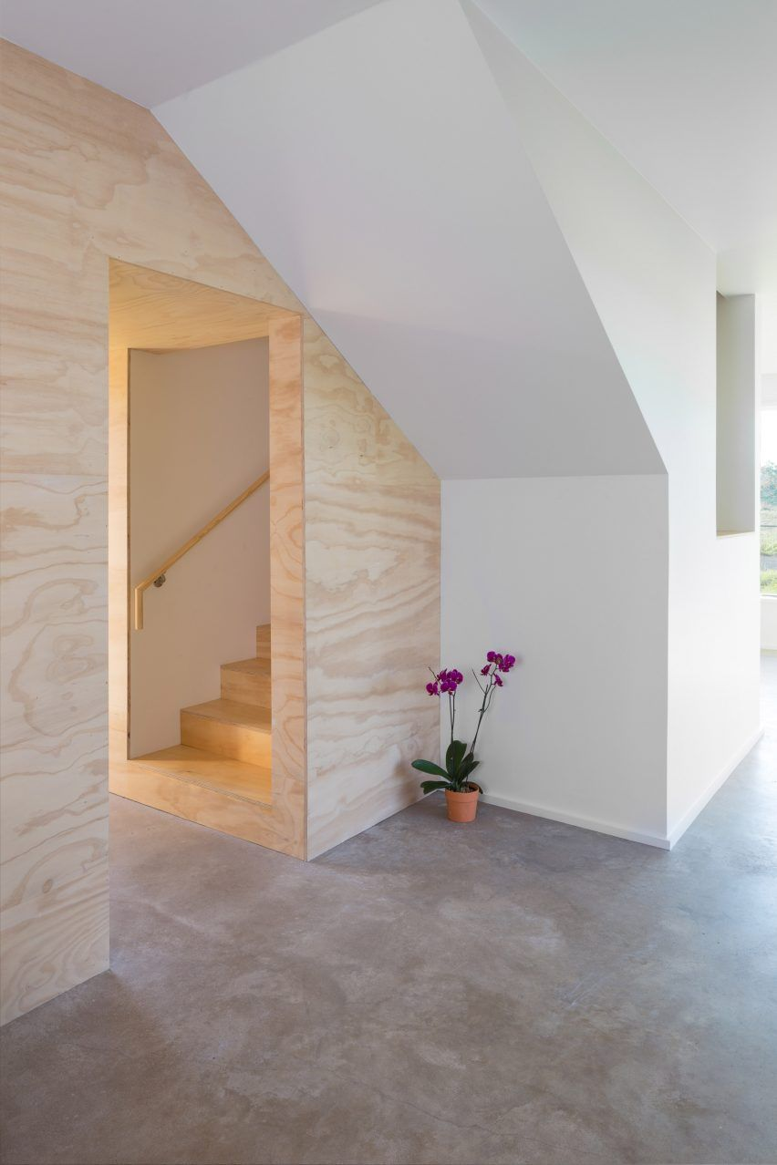 An enclosed staircase is located in the centre of the plan, and was built in pine plywood