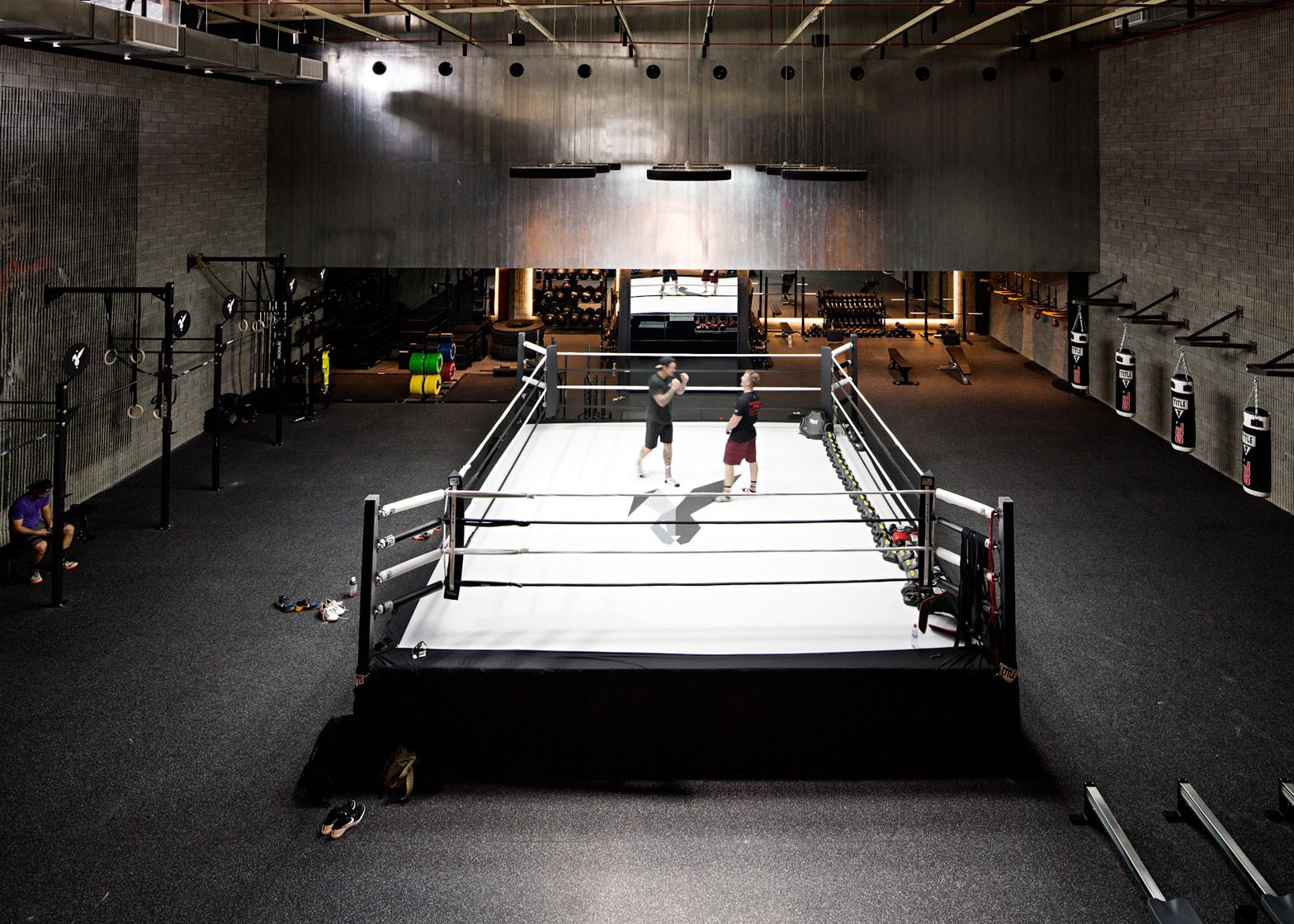 Materials Used Throughout The Burrow Boxing Club In Kuwait Were Influenced By The Simple Interiors Of Retro Gyms Boxing Gym Boxing Gym Design Gym Design