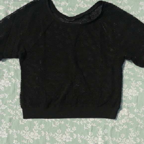 Black top Nice black top with unfinished edge look (see picture of sleeve)  looks great with colored tank top underneath! Tops Sweatshirts & Hoodies