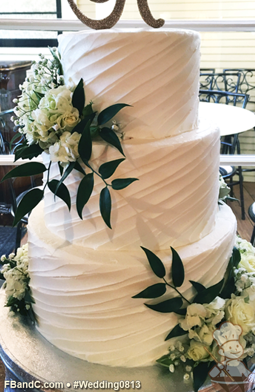Diagonal Textured Butter Cream Wedding Cake With Fresh Flowers