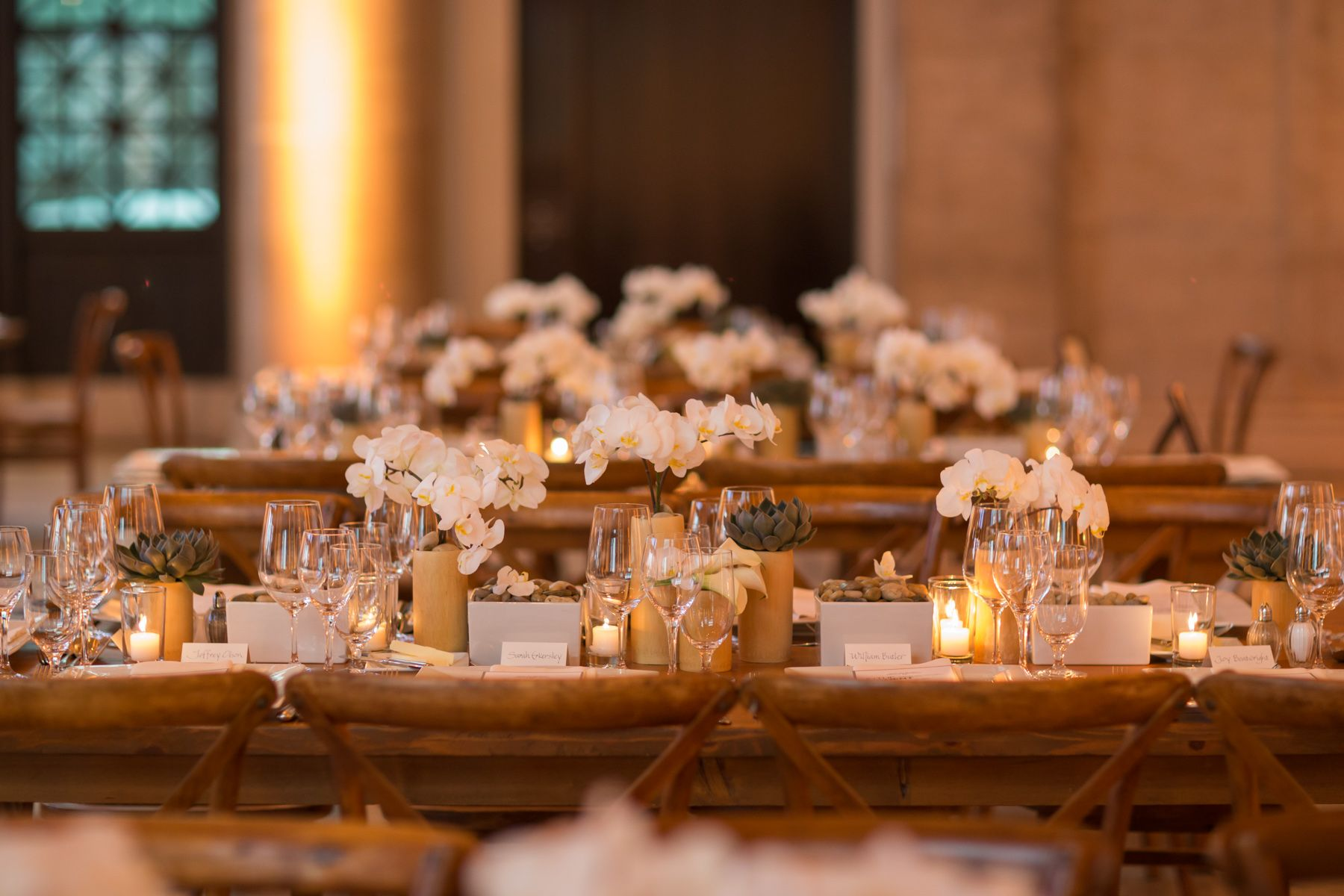 Zen-inspired centerpieces line natural wood queen's tables at this Asian Art Museum event. #mccallsfloral #mccallssf #mccallscatering