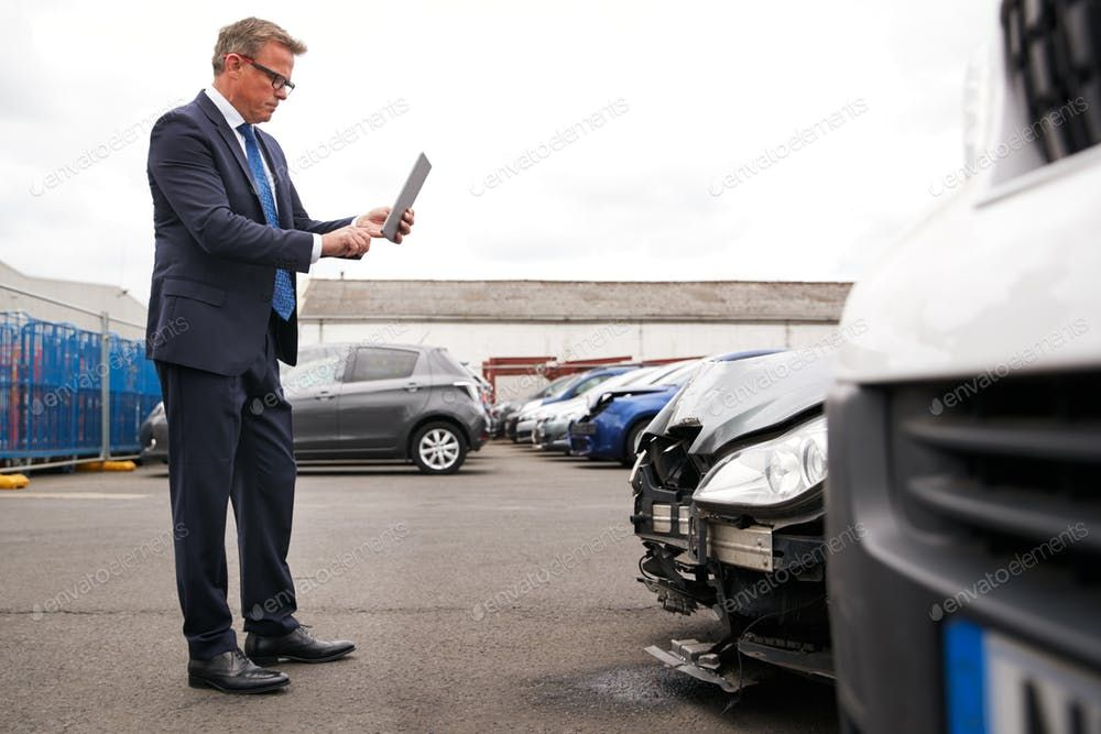 Insurance Loss Adjuster Taking Picture With Digital Tablet Of Damage To Car From Motor Accident Photo By Monkeybusiness On Envato Elements Digital Tablet Taking Pictures Digital
