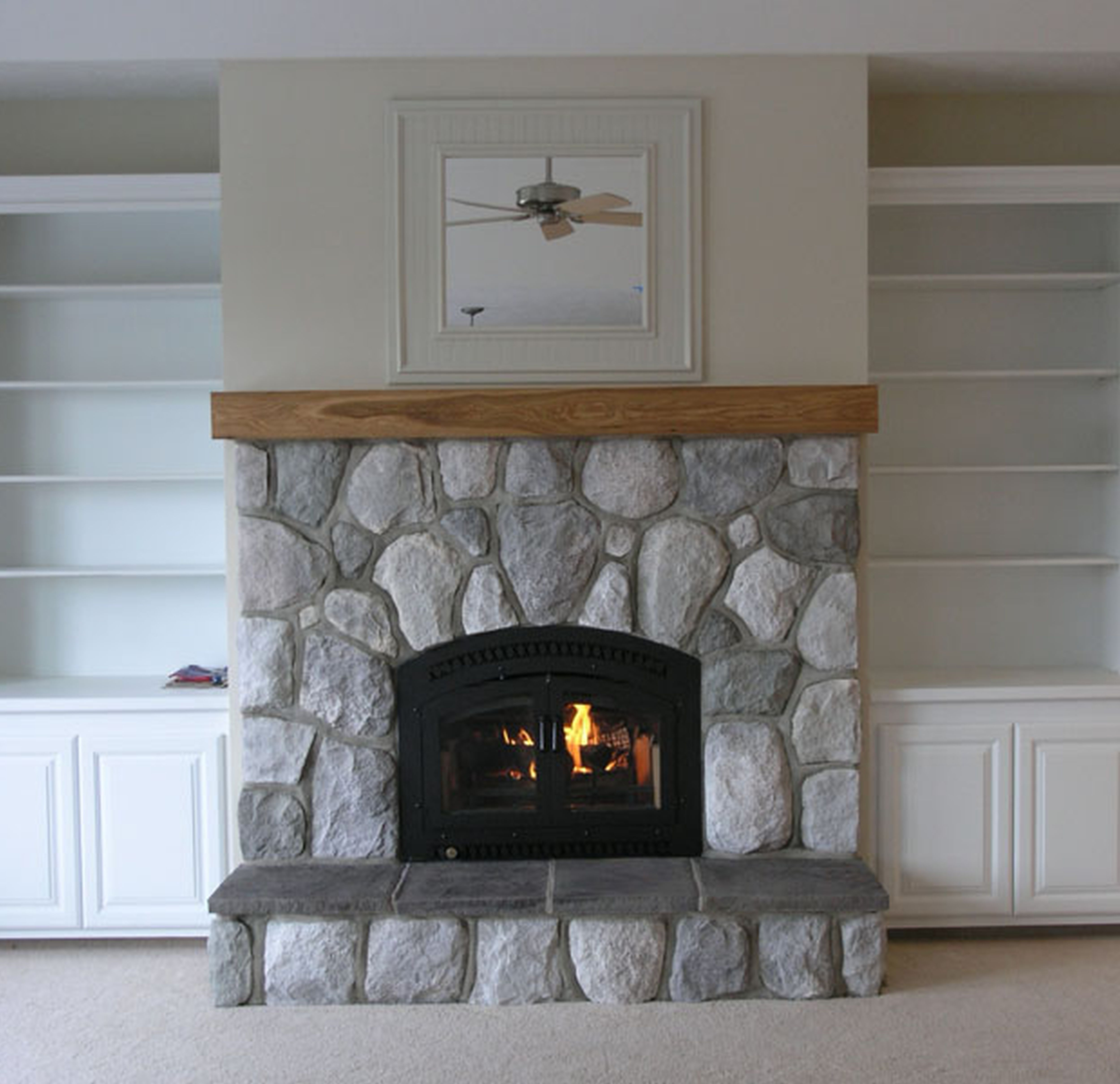Interior Stacked River Rock Fireplace With Double Black Metal Fire Stone Fireplace Surround Painted Stone Fireplace Grey Stone Fireplace