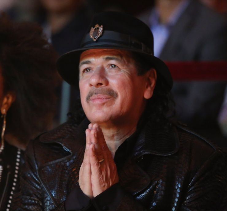 He'll say a little prayer for you. Carlos Santana shows his gratitude at the HBO Latino premiere of Santana: De Corazon on April 16 in New York