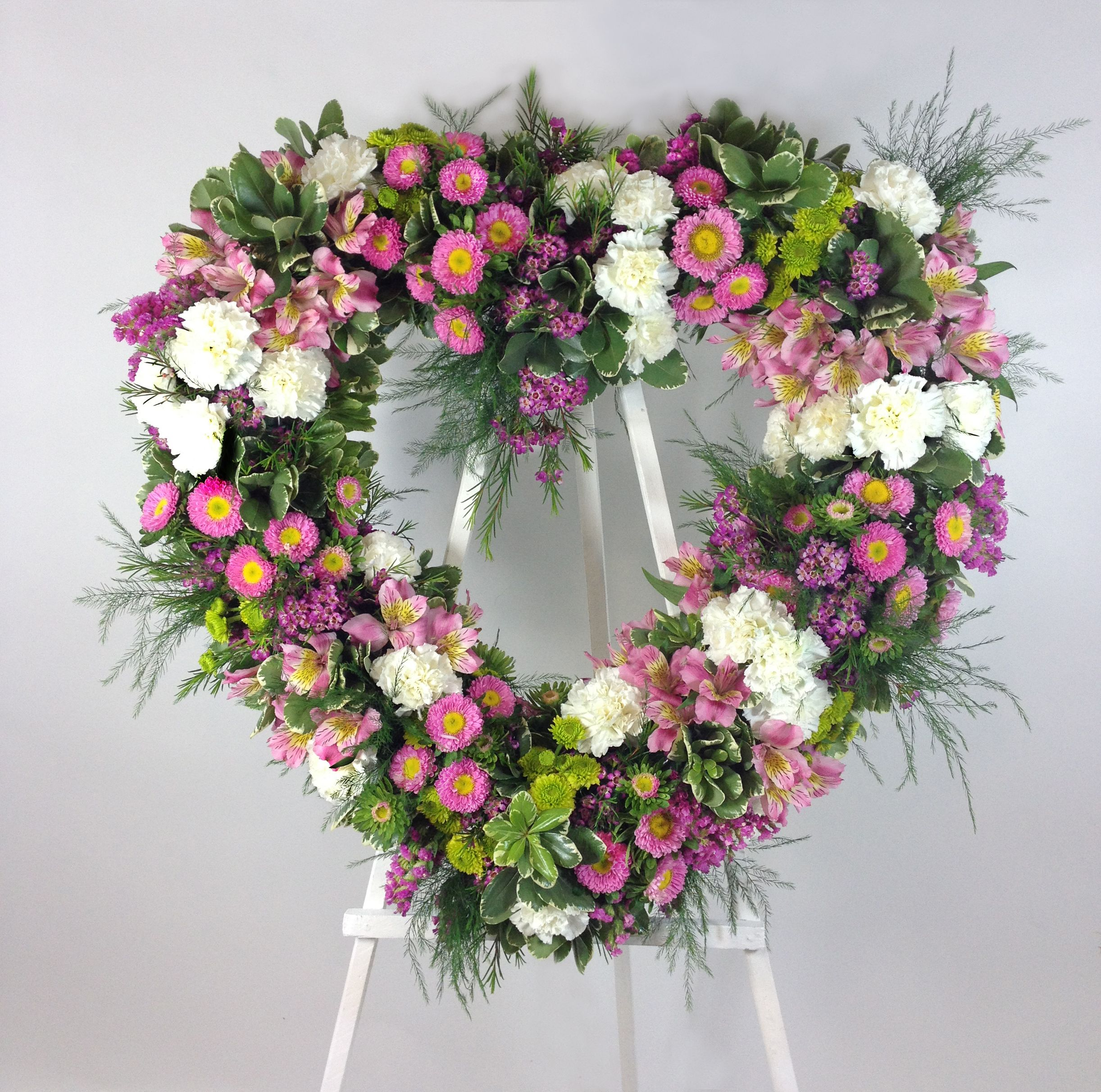 Pink white green heart shape funeral spray with carnations aster pink white green heart shape funeral spray with carnations aster alstromeria izmirmasajfo Gallery
