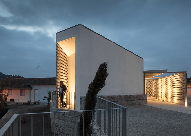 Perforated concrete blocks create patterns of light and shadow inside this mortuary in the Portuguese village of Vila Caiz.