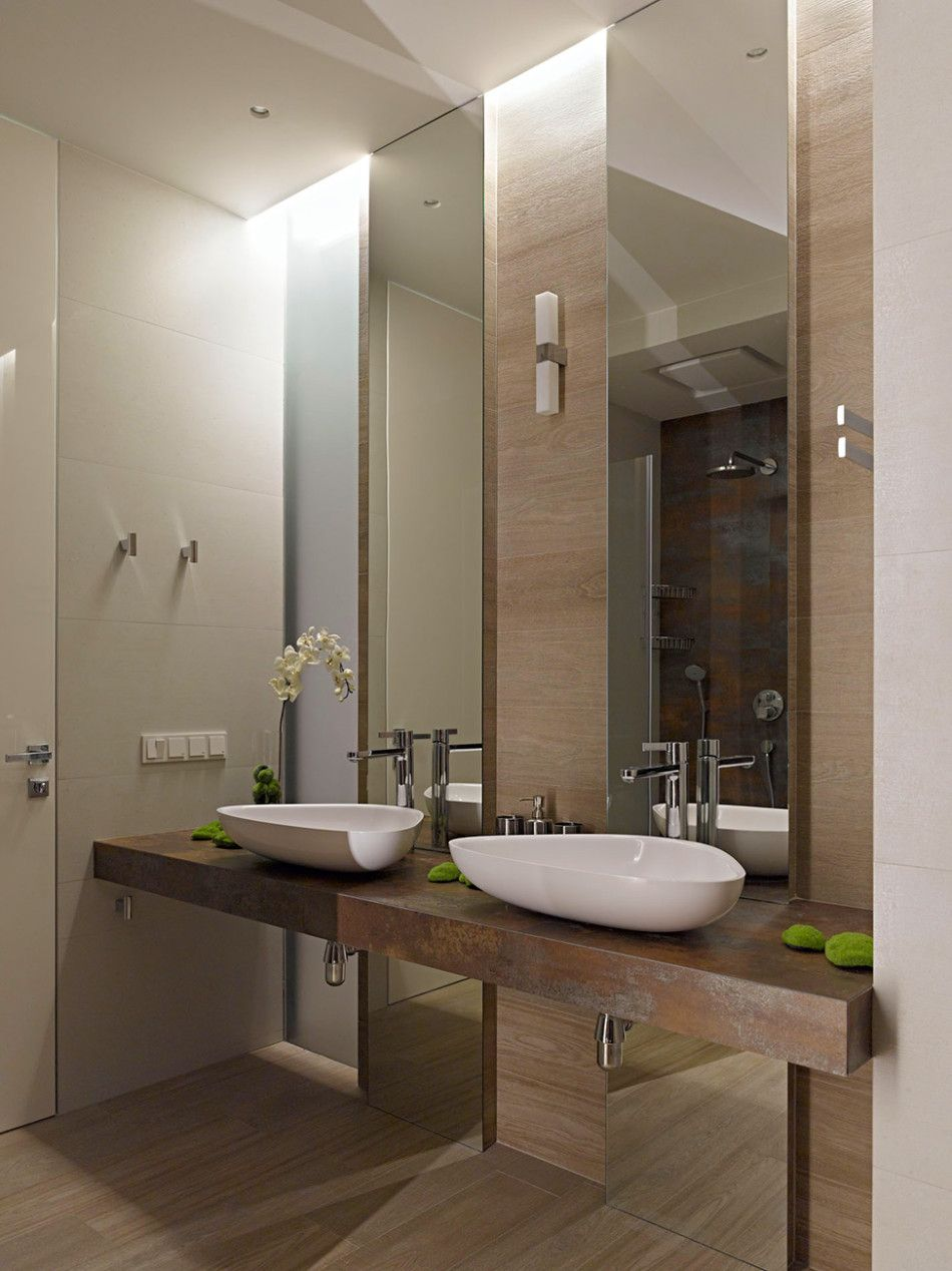 """floor to ceiling mirror panel behind sink bowl; """"floating"""