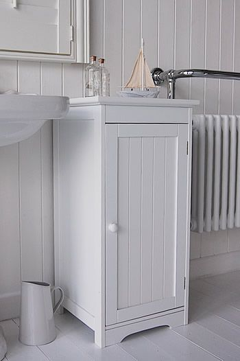 Side View Of Freestanding White Bathroom Cabinet