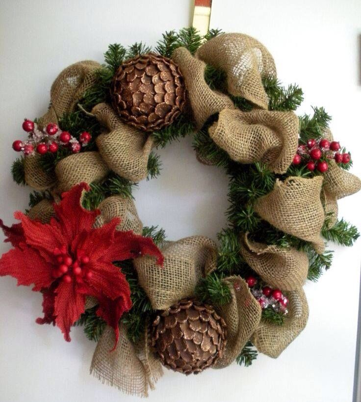 Wreath made of burlap ribbon pine cones pointsetta for Decorating with burlap ribbon for christmas