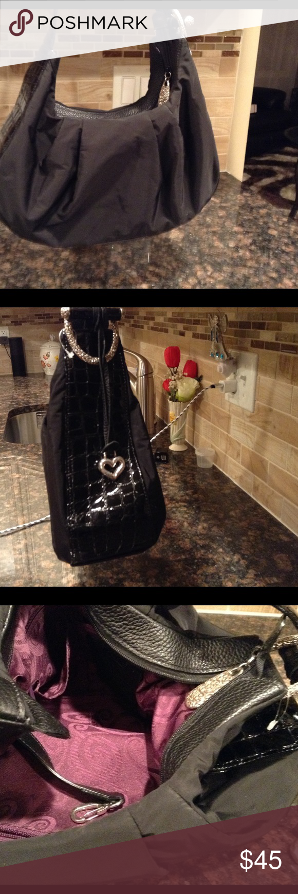 """Brighton bag NWOT Black microfiber with black shiney leather trim with silver accessory trim. 14"""" X 8"""" X 4"""" has a handle drop of 11"""" really nice dressy bag can be used everyday lots of room. Brighton Bags Shoulder Bags"""
