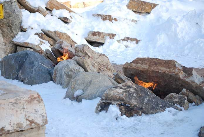 Hidden fire features within stones to warm up the winter months.