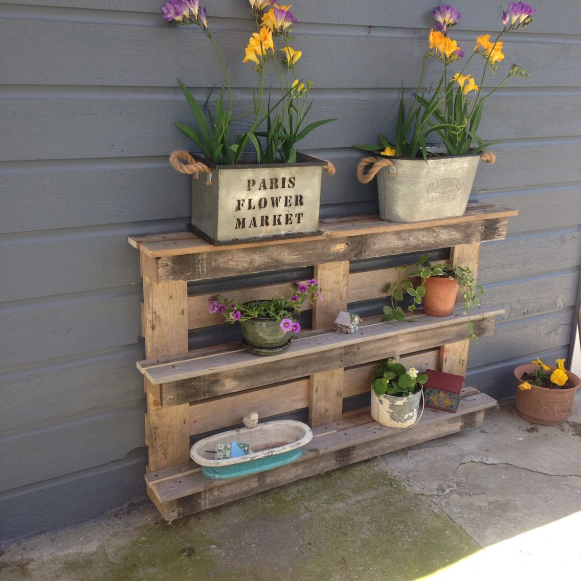 Hubby Built This Cool Pallet Shelf For Our Patio! Love It