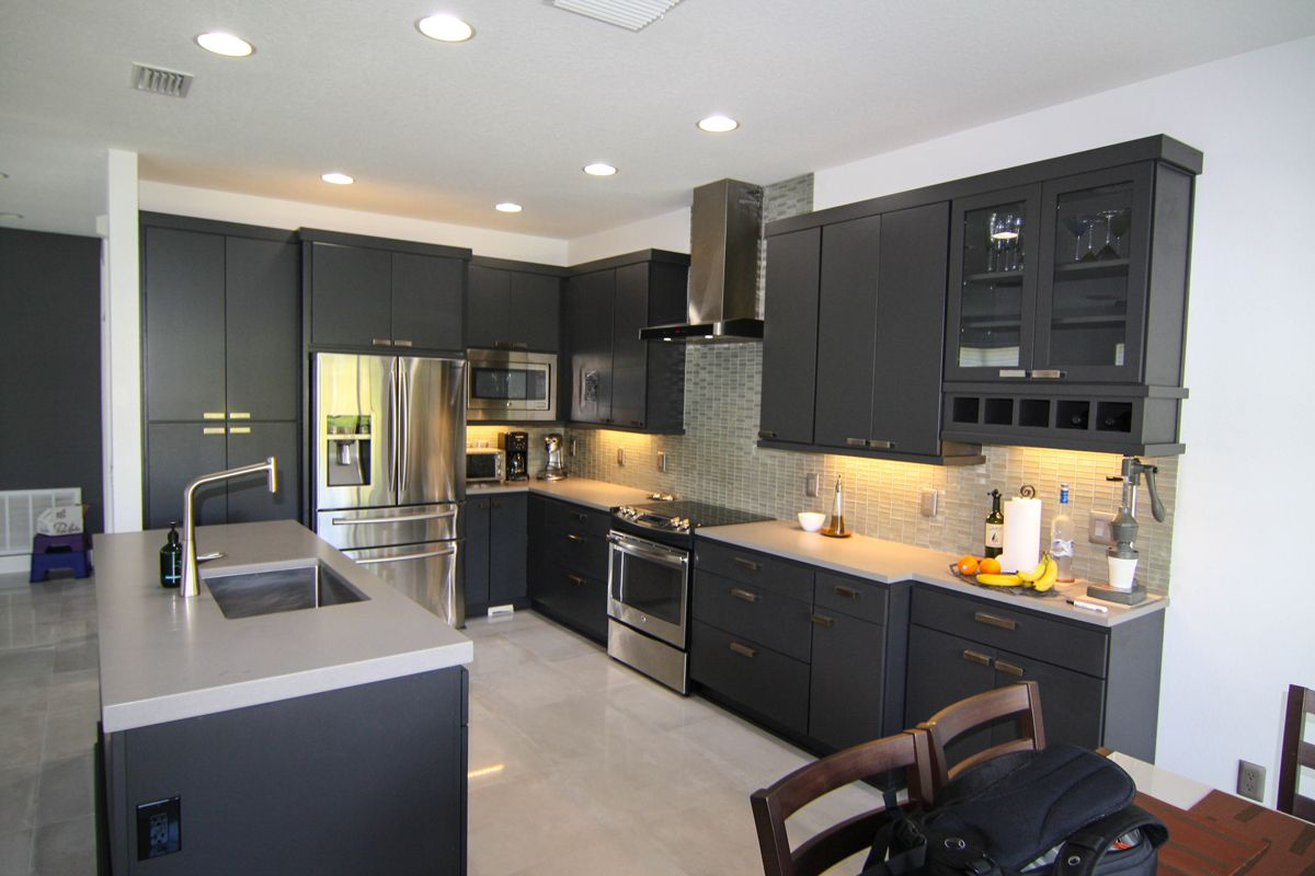 A Kitchen Remodel In Riverview Florida Transformed A Kitchen From Bland And Colorless To Bold And Modern Ro Gray Cabinet Color Kitchen Remodel Pantry Cabinet