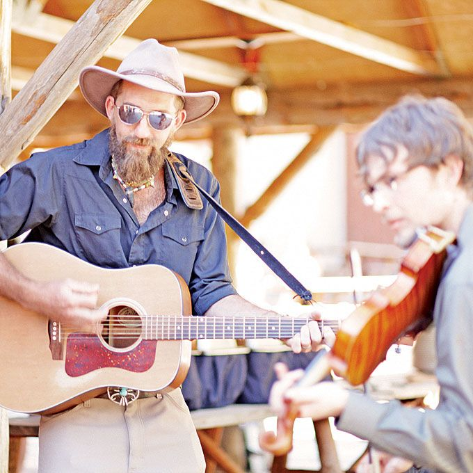 The groom's friend Bobby Kreuch and his cousin Bard Edrington played bluegrass tunes that perfectly suited the rustic atmosphere. Fresh in Love Photography.