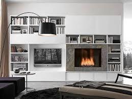 Risultati immagini per camino design con televisione for Living con camino