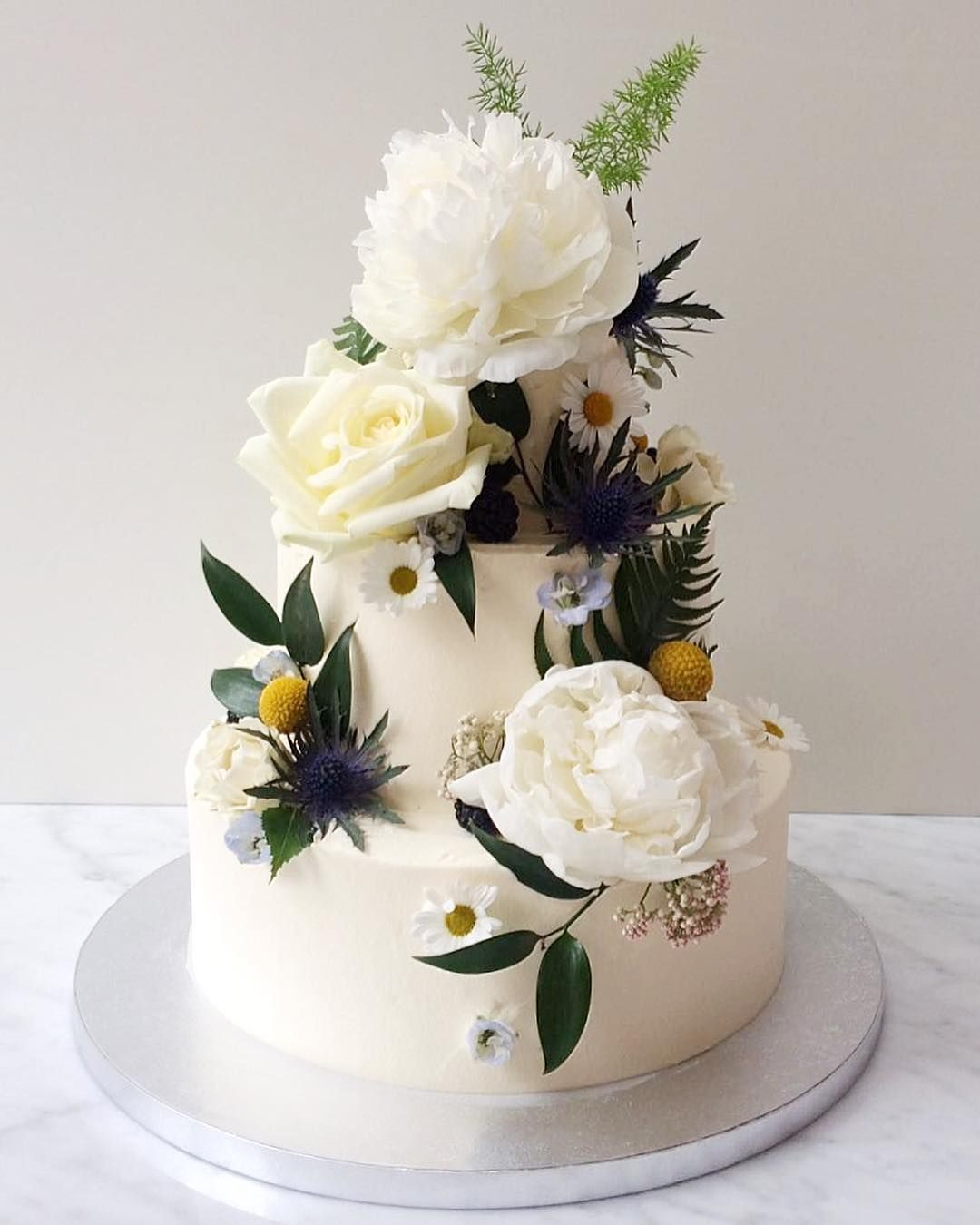 Pretty Spring white-wedding cake in roses and daisies like an ...