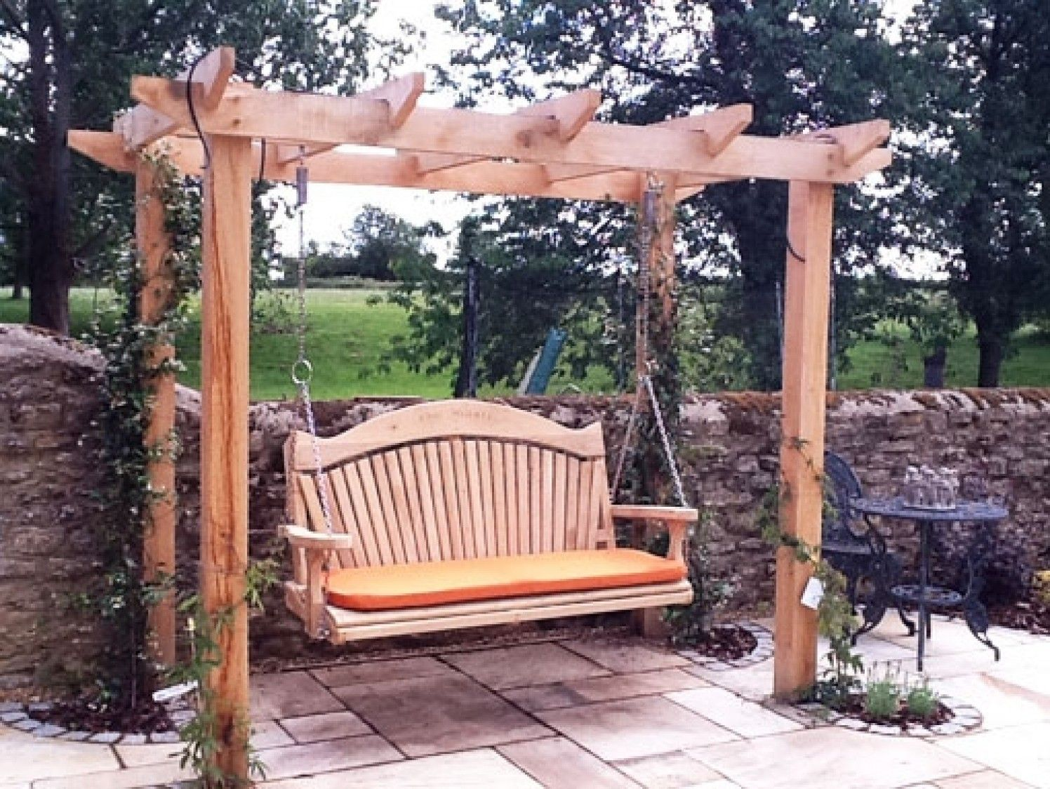 quality wooden swing seat and pergola out side the house. Black Bedroom Furniture Sets. Home Design Ideas