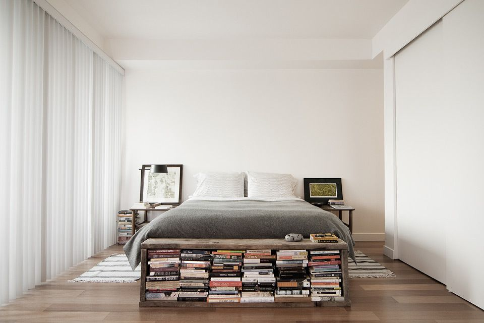 minimalist modern bedroom with bench / bookcase at the end of the ...