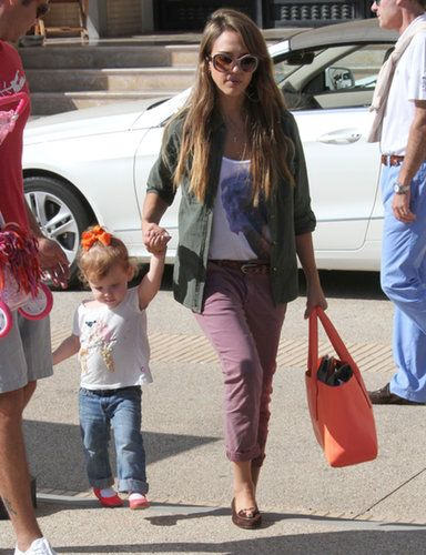 During a day out with her family, Jessica Alba got creative by matching her olive blouse with mauve khakis and nude sunglasses.                   Source: FameFlynet