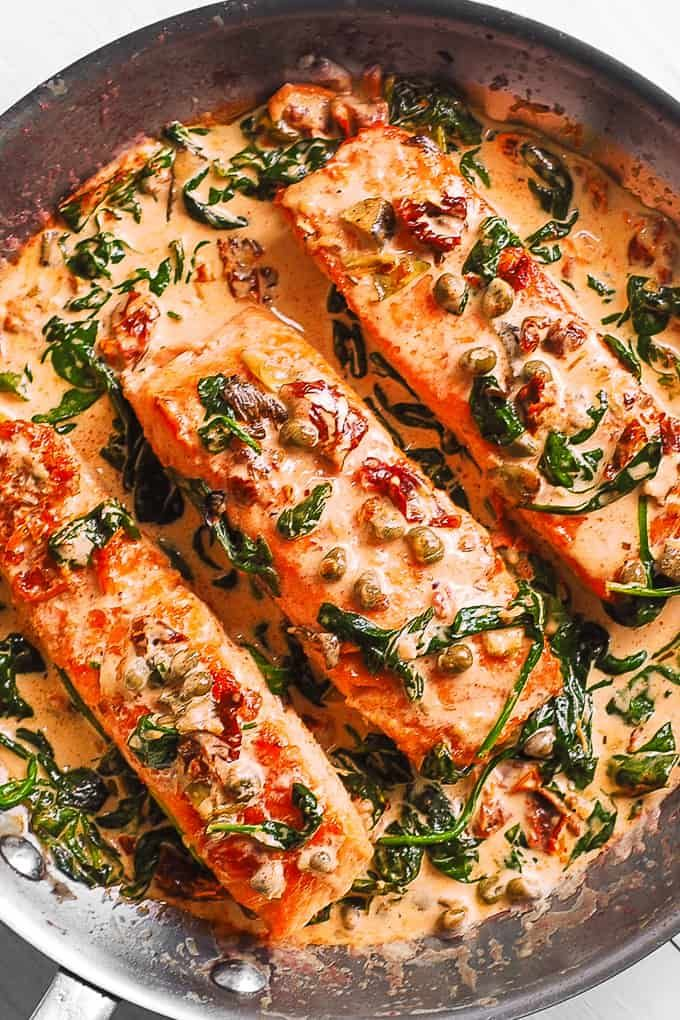 Creamy Tuscan Salmon with Spinach, Artichokes, and Garlic